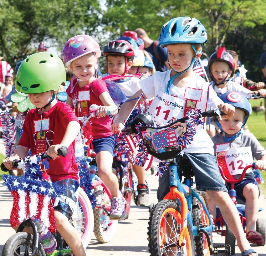 "Area youngsters navigate their bicycles during the ""Pedals and Paws"" portion of Northglenn's Fourth of July Festival, held July 4 at E.B. Rains, Jr. Memorial Park."