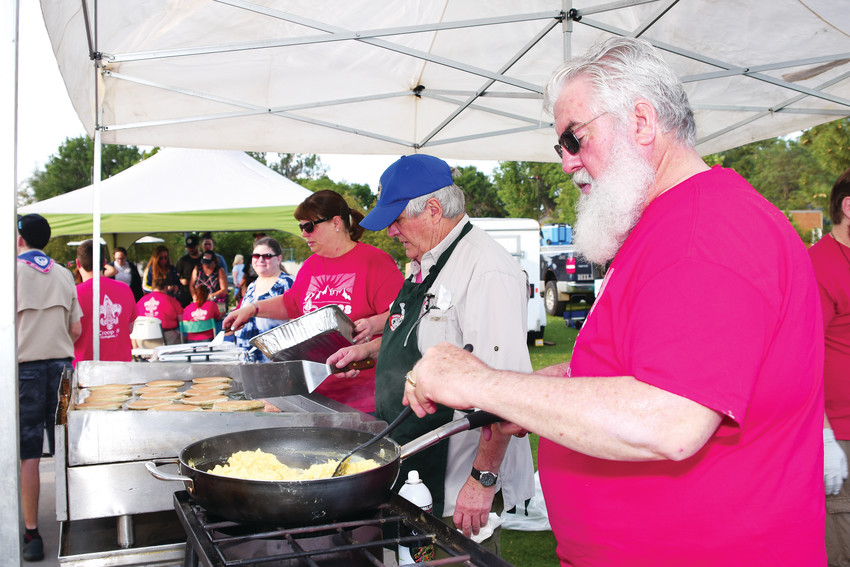 Bob Frank, an adult volunteer with Boy Scout Troop #98, cooks scrambled eggs at the troop's 27th annual Pancake Breakfast, part of Northglenn's July 4th Festival, at E.B. Rains, Jr. Memorial Park. Frank noted that 150 dozen eggs are prepared for the breakfast.