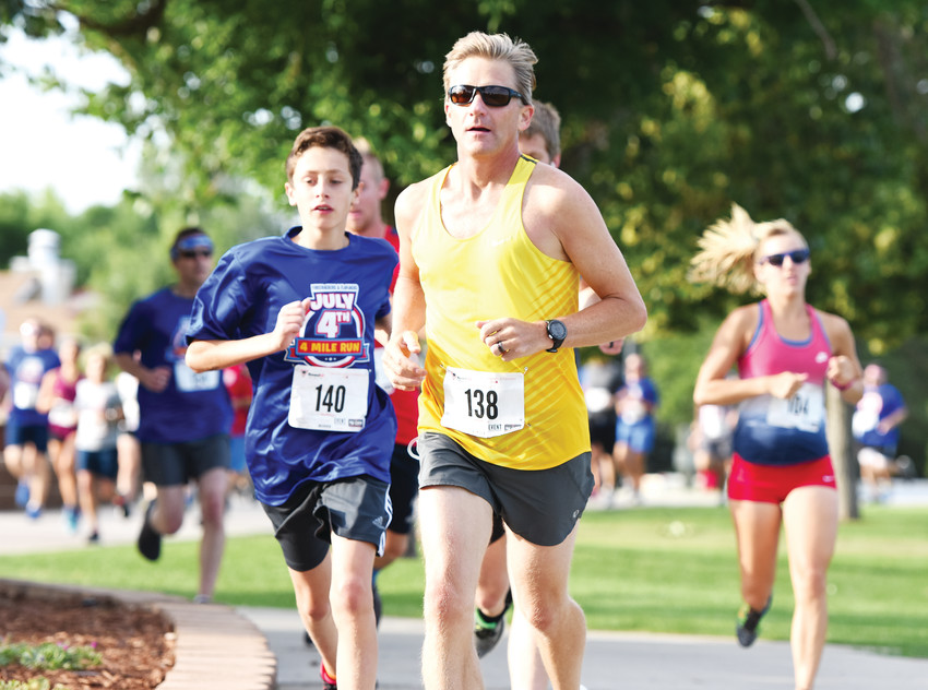 Chris McDonald of Niwot, center, and Cian Nagle, left, were among the early leaders of Northglenn's 4 Mile Run, part of the city's Fourth of July Festival at E. B. Rains, Jr. Memorial Park.