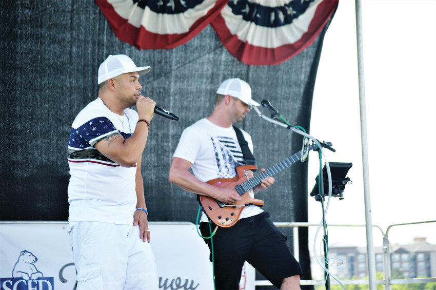 Rapper Buddhakai and guitarist Dave Connelly warm up the July 4 stage at Westminster's City Park for the city's annual Independence Day celebration.