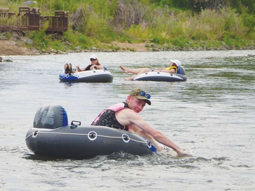 Tubers float down the South Platte River in Littleton last summer. The City of Littleton closed the river to recreation on July 14 after a Facebook event inviting people to float the river drew thousands of RSVPs, despite extremely low water levels. 