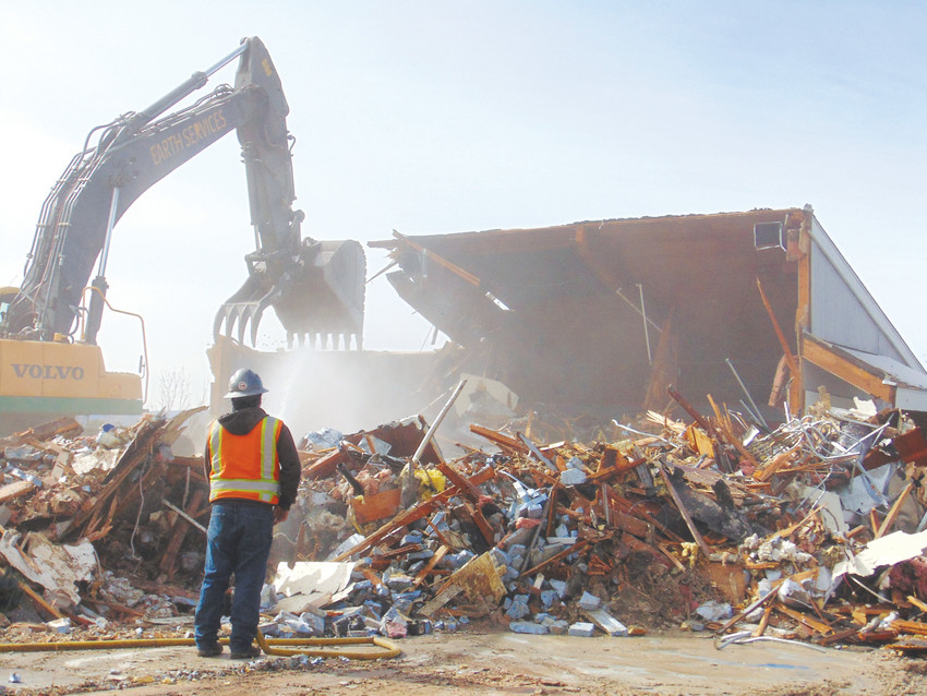 Workers demolish the long-derelict Columbine Square Shopping Center in February. The Belleview Corridor Plan spells out a bright future for the region, but what will become of Columbine Square is still a mystery.
