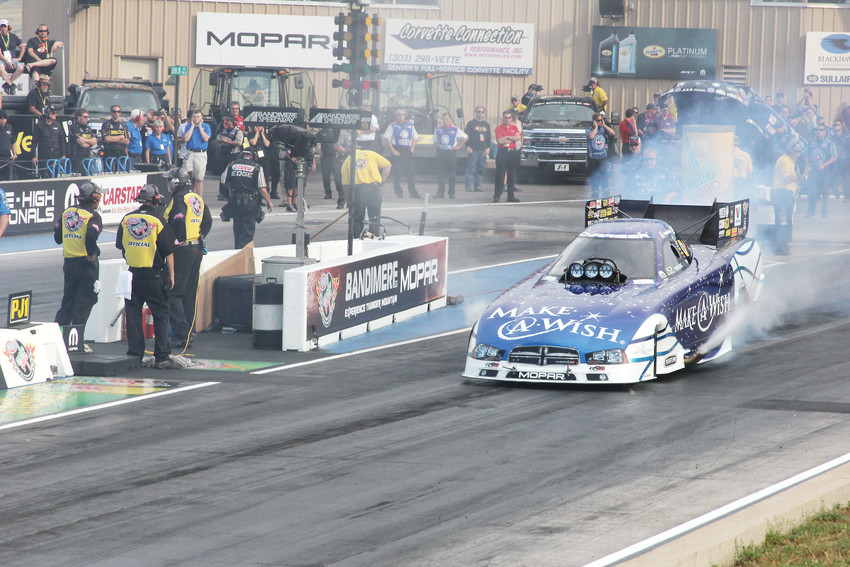 The Make-A-Wish funny car does a burnout during the 2016 Mile High National Drag Races at Bandimere Speedway. Most of the major teams are expected at the Mile High event July 20-22 which is one stop on the 23-race National Hot Rod Association annual schedule.