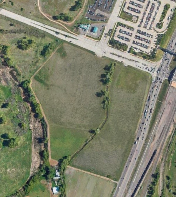 Hundreds of apartments and numerous retail and office buildings could rise from the north 33 acres of the old Ensor property, south of the Mineral light rail station, if new owner Evergreen Devco's plans are approved.