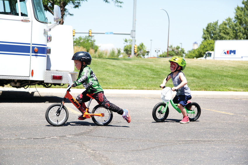 Above, Axel Sakich, 4 and Tatum Morris, 3, compete in a Strider bike race July 10 at the Arvada Marketplace Connection Anniversary Summer Bash.
