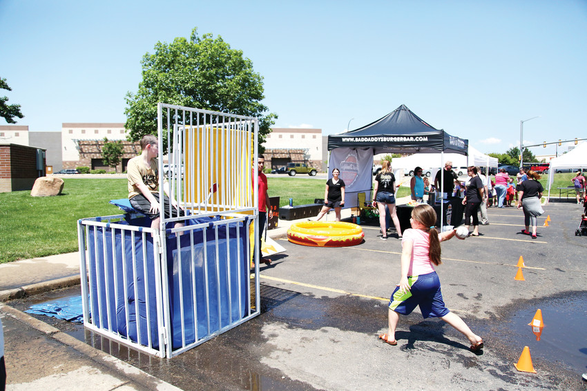A dunk tank was the center of attention for many trying to beat the heat July 10.