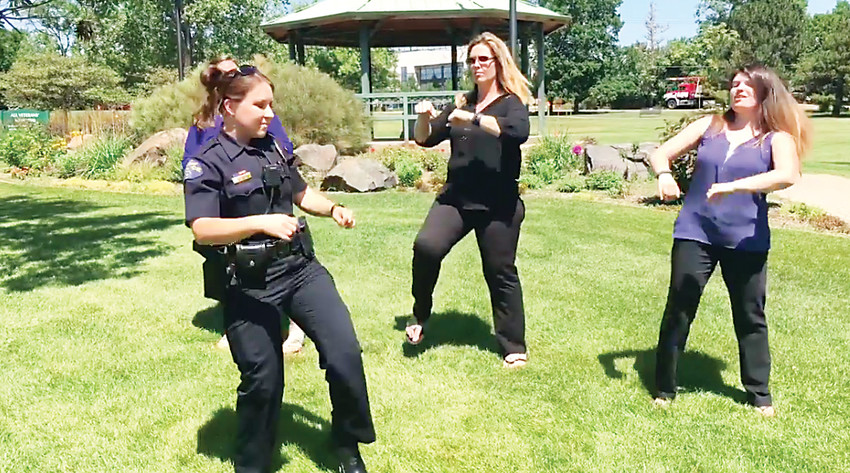 A screenshot from the Wheat Ridge Police Department video entry to a lip sync challenge.