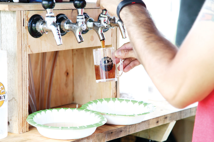 Beer samples flowed all afternoon at Aravada On Tap held July 21 at the Ralston Park Addition.