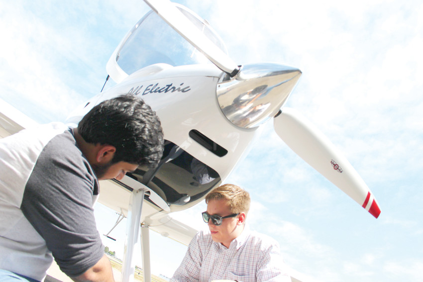 Parijaat Malik, left, and Steve Almer put finishing touches on Bye Aerospace's Sunflyer 2, an experimental all-electric two-seater airplane.