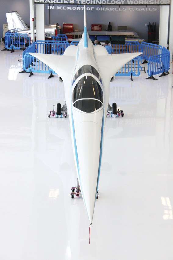 "A quarter-scale mockup of ""Boom,"" an experimental supersonic airliner, dominates the center of Exploration of Flight. The real plane is under development in a nearby hangar."