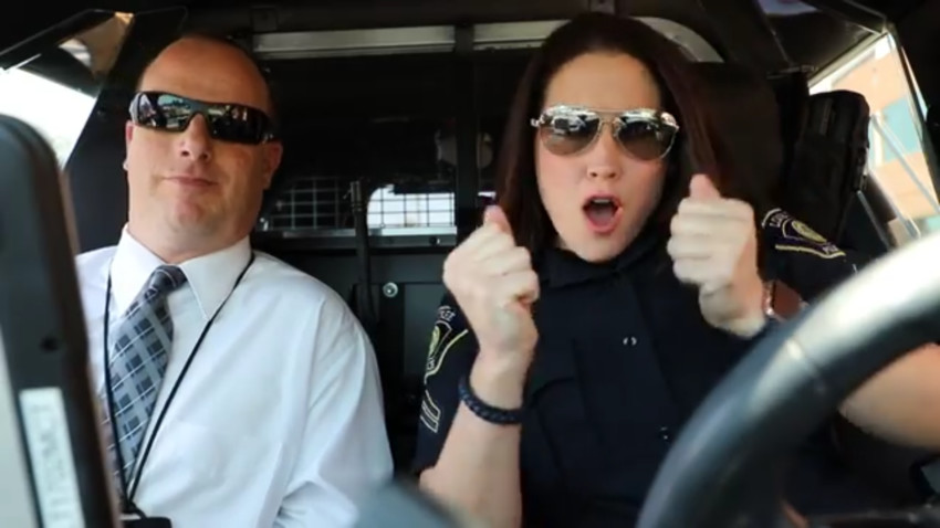 "Lone Tree Police Department Cpl. Jessica Chaine and Cpl. Jeff Gould lip sync Carrie Underwood's ""The Champion"" as part of a viral video challenge."