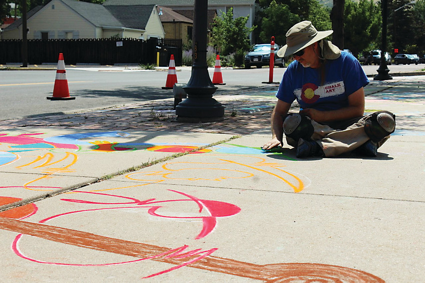 Chalk artist Michael Rieger creates on a sidewalk in downtown Golden on July 17 as part of ARTSWEEK GOLDEN, an event put on by Foothills Art Center that took place July 16-22 at various in-and-outdoor venues.