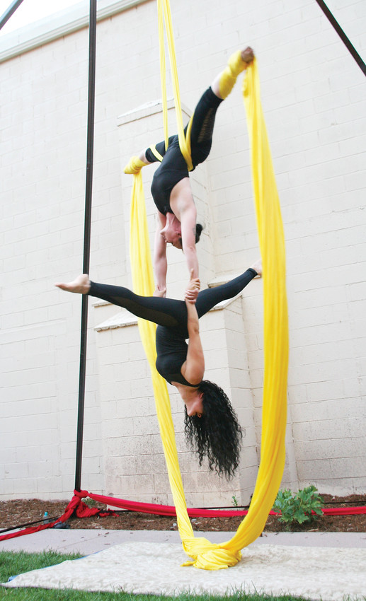 Aerialists Jill Scott and Michelle Villalobos perform on July 19 at the Foothills Art Center Courtyard as one of the attractions for ARTSWEEK GOLDEN, an event put on by Foothills Art Center.