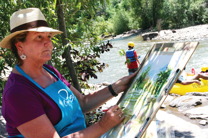 Janet Kucks of Arvada paints a watercolor landscape En Plein Air along Clear Creek in Golden during ARTSWEEK GOLDEN, an event put on by Foothills Art Center that took place July 16-22 at various in-and-outdoor venues.