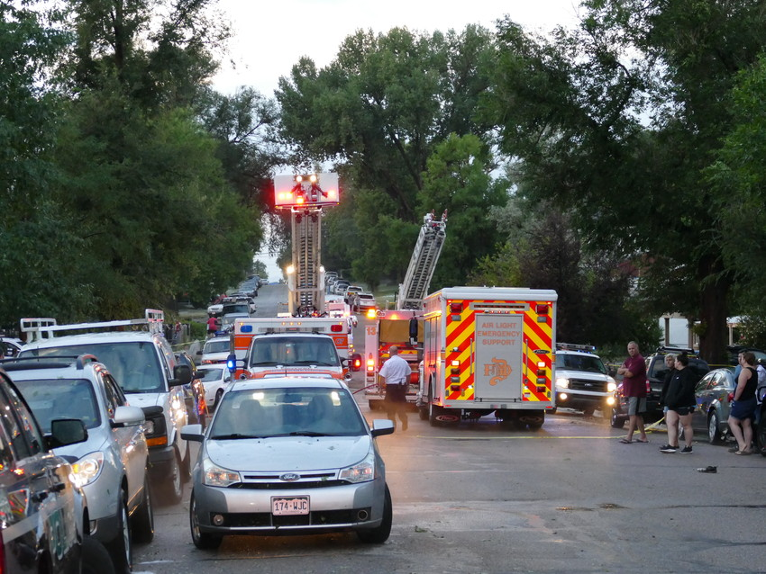Denver firefighters respond to the scene of an Englewood home, where the basement flooded and a woman died.