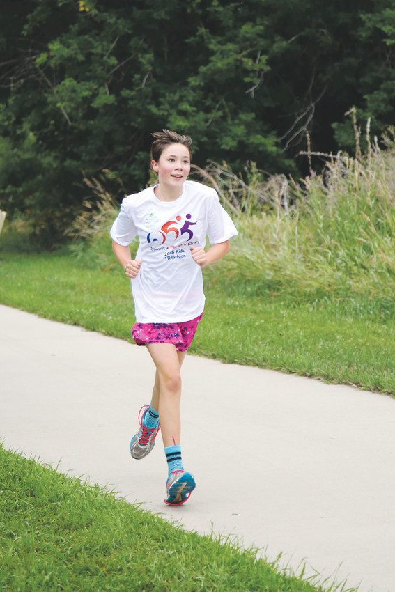 Nia Dark was the first competitor to cross the finish line at Apex Kids' TRYathlon held July 29.