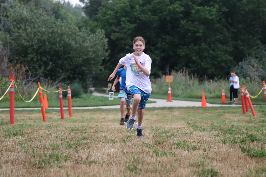 Declan Gunther runs the final stretch to the finish line July 29.