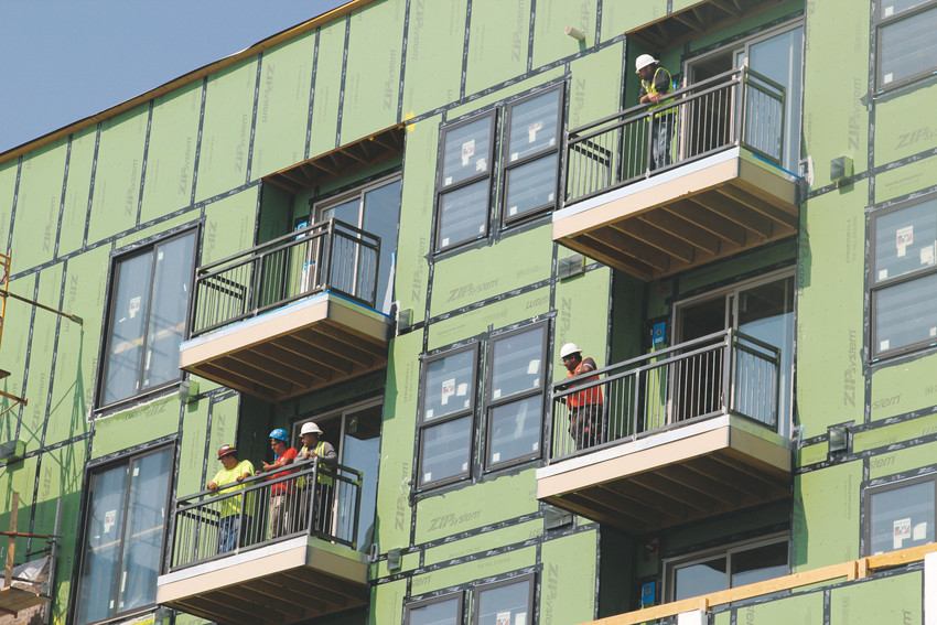 Families and children weren't the only ones watching the parade on July 28 — construction workers on the Riverwalk Project paused to watch the event from balconies of the rising building.