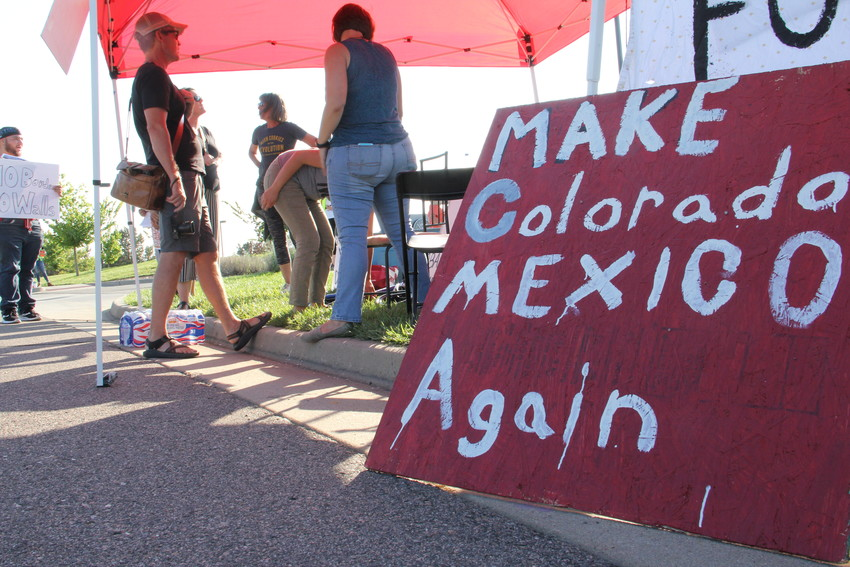 A group of protesters opposed to federal immigration policies stands July 31 amid their signs. At the U.S. Immigration and Customs Enforcement (ICE) Denver Field Office at 12445 E. Caley Ave. in Centennial, protesters set up an encampment and planned to stay for a week.