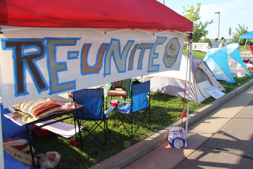 Tents line the street July 31 in front of the U.S. Immigration and Customs Enforcement (ICE) Denver Field Office at 12445 E. Caley Ave. in Centennial. Protesters set up an encampment and planned to stay for a week.