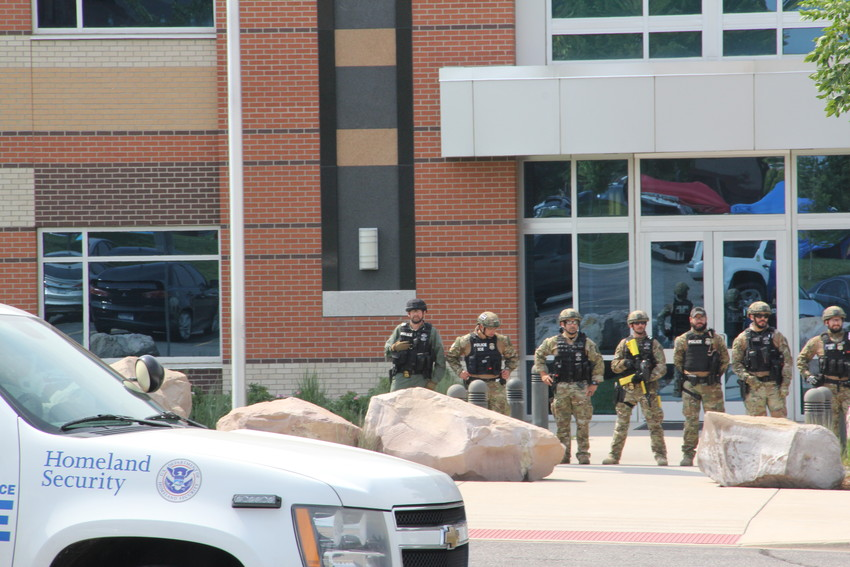 Officers in tactical gear in front of the U.S. Immigration and Customs Enforcement (ICE) Denver Field Office Aug. 2. Police with the Department of Homeland Security were on scene. Protesters formed blockades at entrances to the parking lot.
