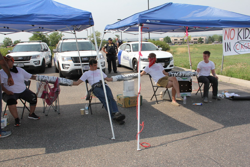 Four of the protesters who used material to link their arms and block an exit from the parking lot at the U.S. Immigration and Customs Enforcement (ICE) Denver Field Office at 12445 E. Caley Ave. in Centennial Aug. 2. The four had their bonds cut with a tool by officers, who then detained them.