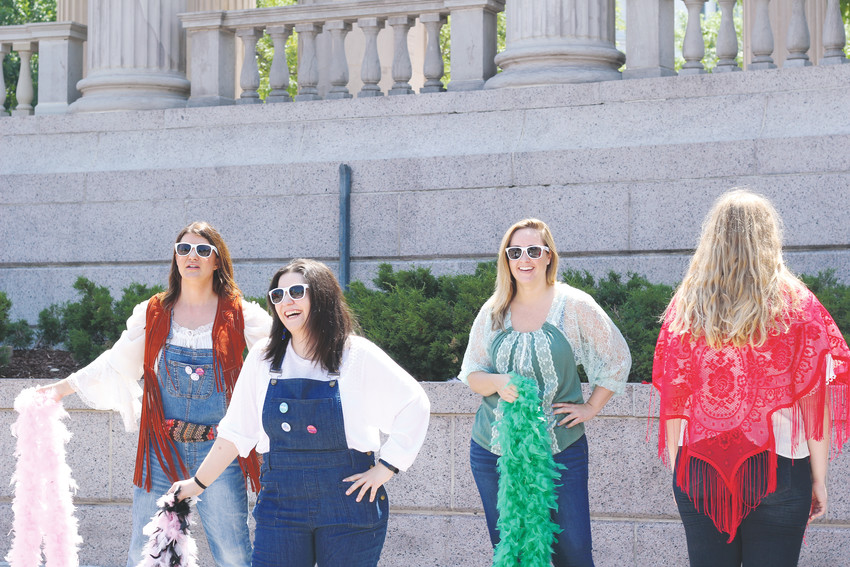 "A group of friends practice a dance based around the new ""Mamma Mia"" movie at Civic Center park."