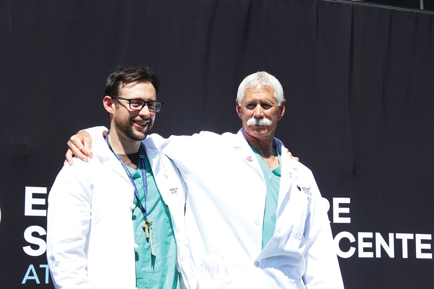 Ernest Moore, right, stands with his son Hunter, who followed in his footsteps and also became a surgeon.