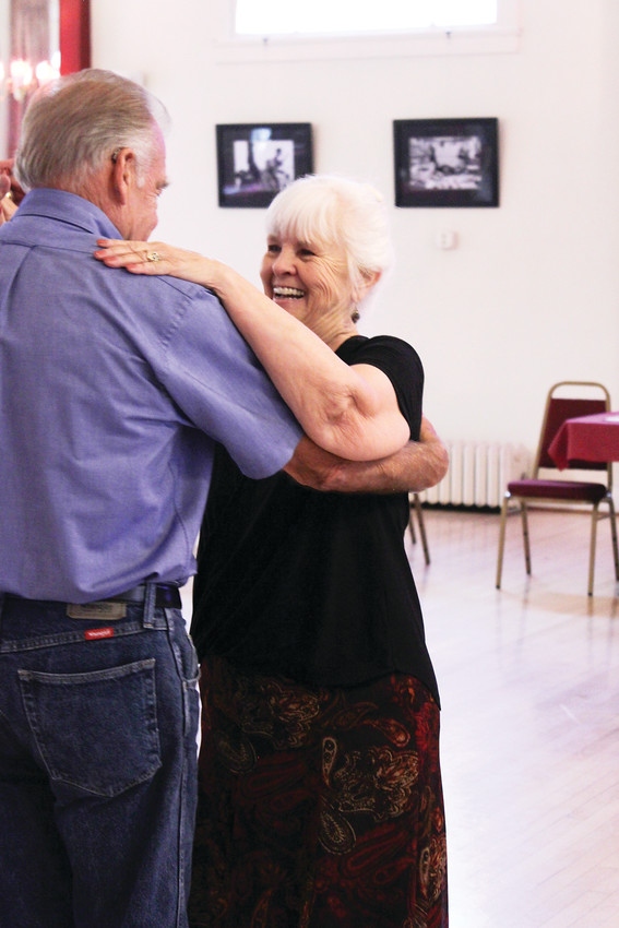 Tango Colorado offers dance lessons on Tuesdays, followed by an open floor for dancers of every level. This couple had a quick laugh during the milonga at the Turnverein.