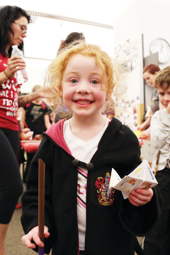 Sierra Hill, 4, was excited to show off her Gryffindor house robe and the wand she made at the Arvada Library Harry Potter party July 31.