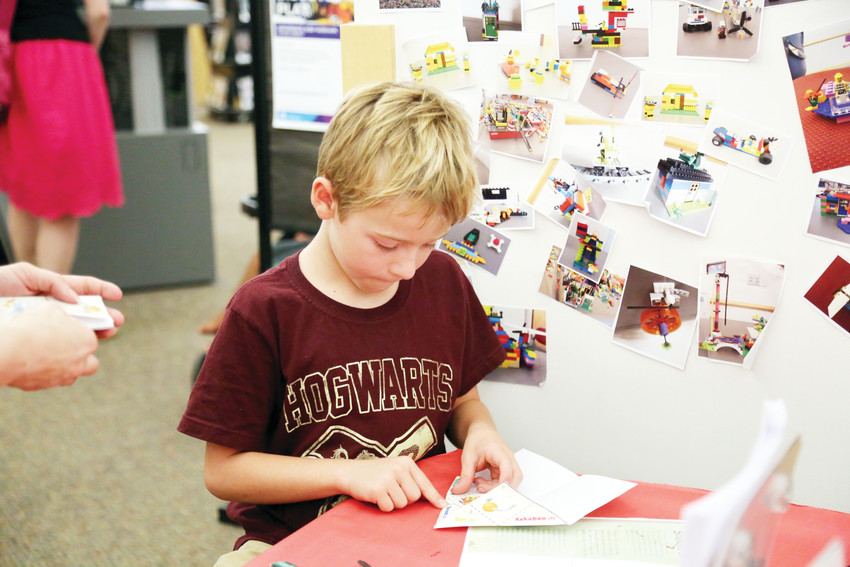 Hunter Hill, 8, works on making a sorting craft at the July 31 Harry Potter party at the Arvada Library.