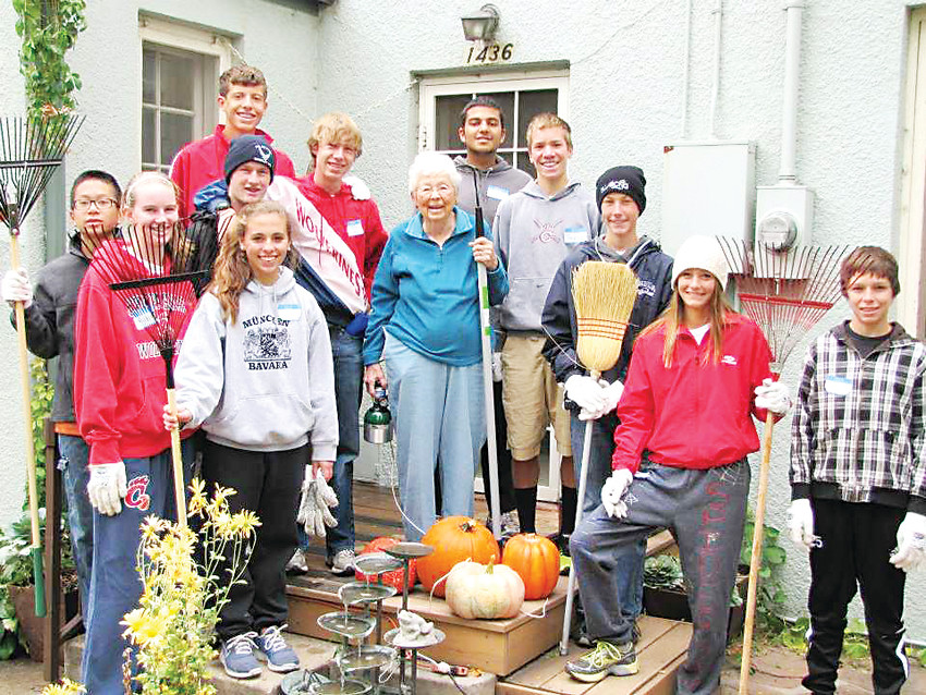 A group of volunteers after doing yard work with A Little Help. The nonprofit started in Washington Park, but has since expanded to nearly 3,000 volunteers throughout Colorado.