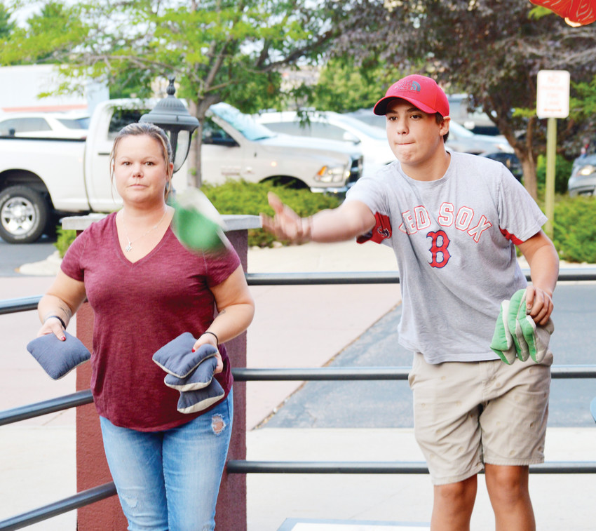 Caleb Valdez and his mother Naomi Hettig of Lone Tree take part in a casual cornhole tournament on Aug. 1 at Reeds Southside Tavern in Lone Tree.