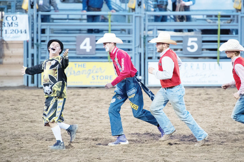 Rodeo clown Robbie Hodges, left, and some clowns in training have fun during a break in rodeo events.