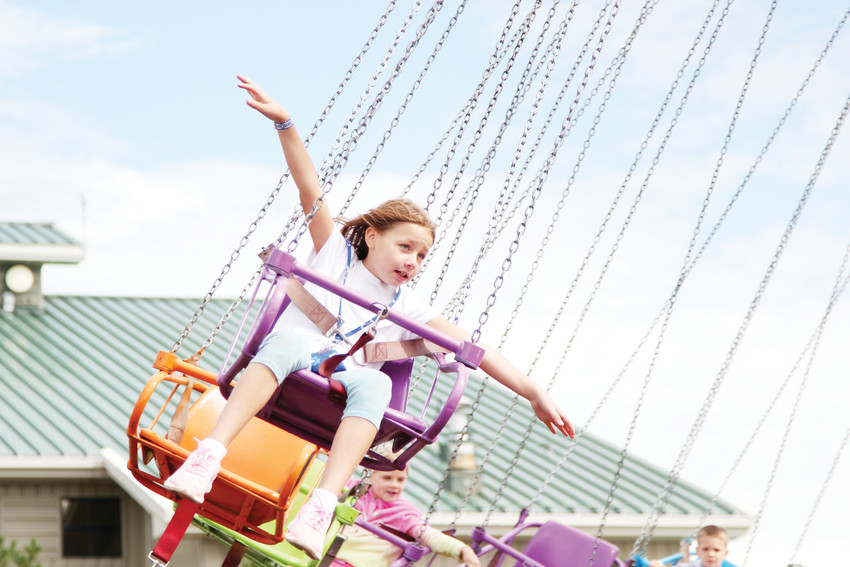 Taylor Dyer, 9, waved to her mother from a ride at the Douglas County Fair and Rodeo on Aug. 3 and pretended to fly.