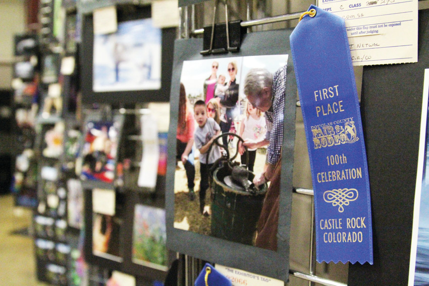 Ribbons on 4-H exhibits helped mark the 100th celebration of the event, which has run consecutively since 1918.