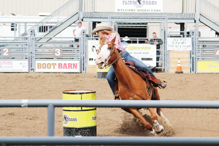 Rodeo royalty — queen and princesses — competed in a barrel race in the outdoor arena on Aug. 3 at the Douglas County Fair & Rodeo.