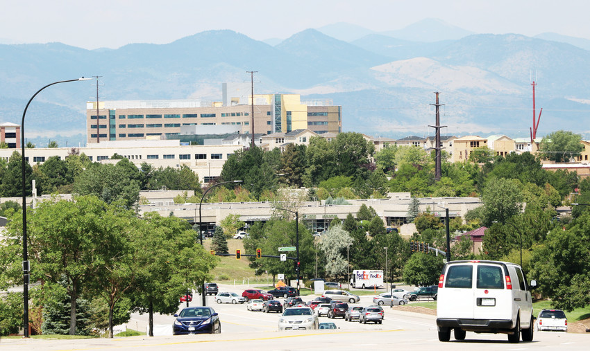 The view heading west on Highlands Ranch Parkway, near the South Broadway intersection, is changing with the construction of UCHealth Highlands Ranch Hospital's expansive campus in Central Park. The building is among the largest structures in the area.