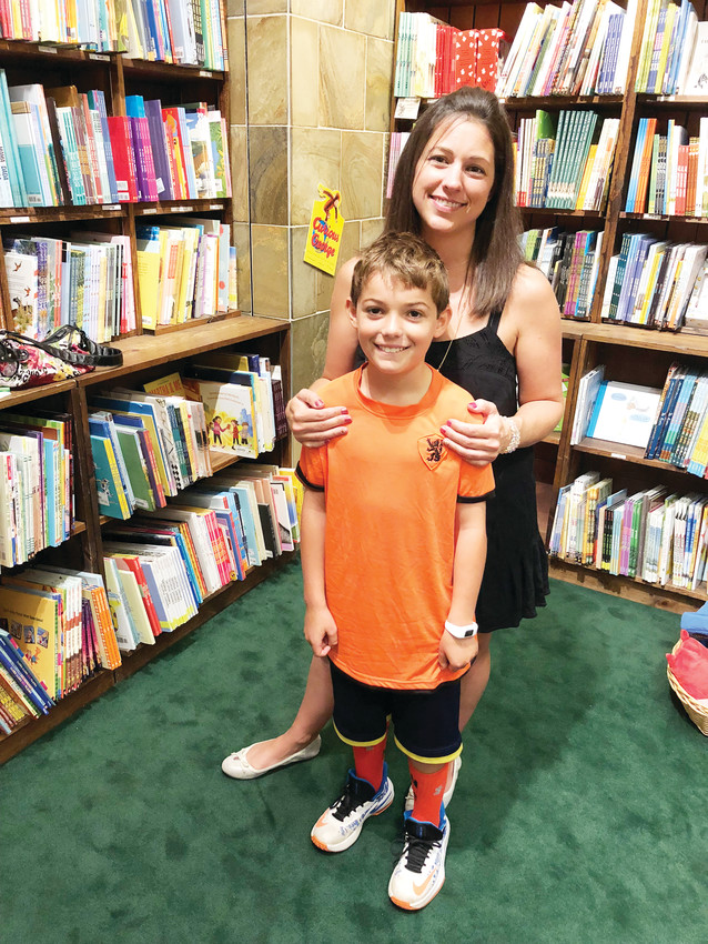 Heidi and Maddox Herman from Littleton say they prefer stopping at independently-owned Tattered Cover when they want to shop at a bookstore.