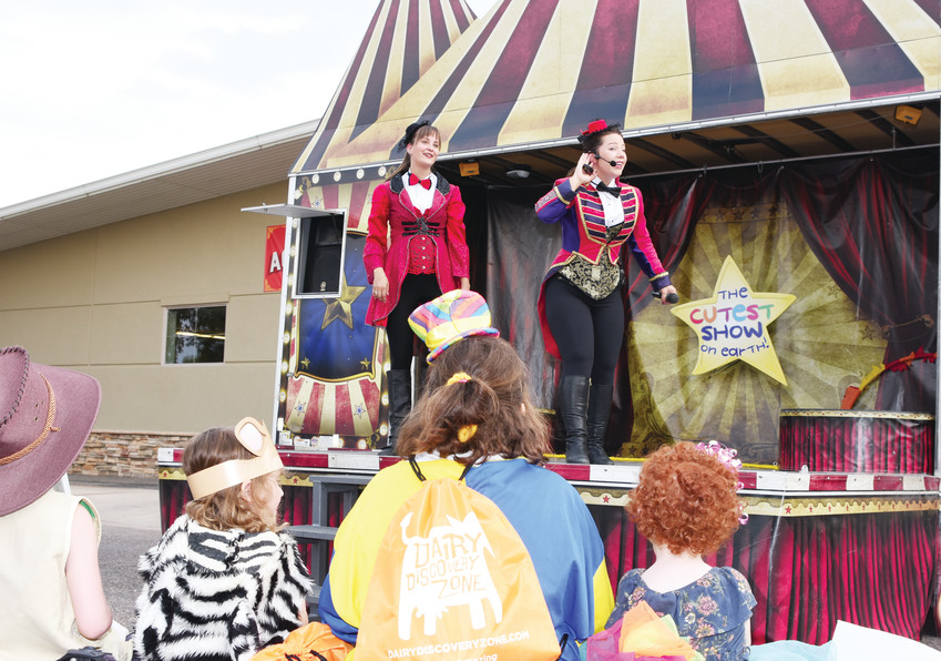 "Performer Nikki Passmore of Canfield, Ontario, talks to her audience during a matinee of ""The Cutest Show on Earth"" at the 2018 Adams County Fair Aug. 1 at Adams County Regional Park. At left is her co-star, Sandra McNeil, of Vancouver, Canada."