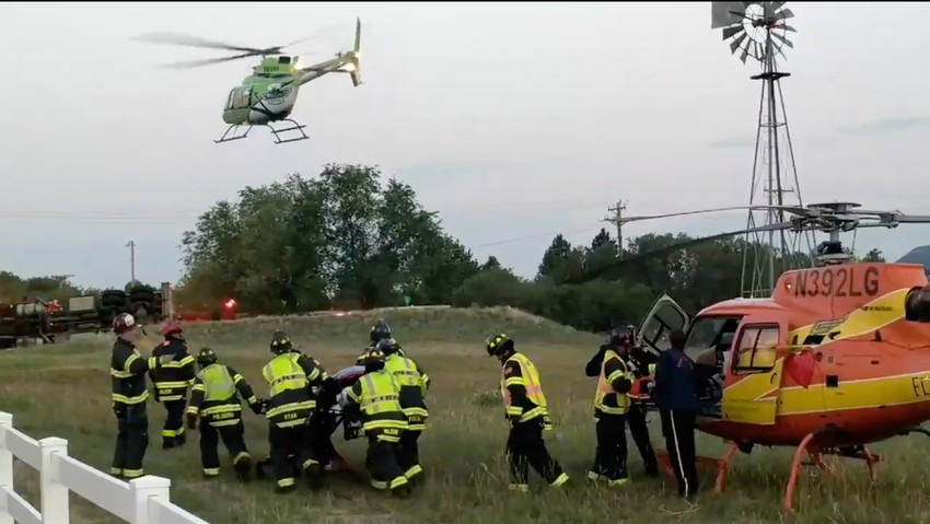 A helicopter takes off from the scene of a crash where two firefighters were airlifted to Swedish Medical Campus after their tanker rolled.