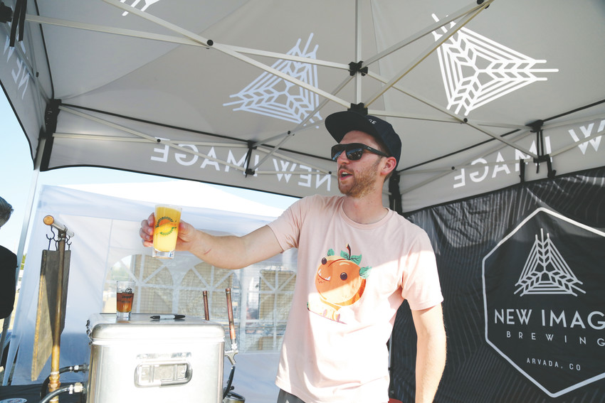 Sean Fisher, with New Image Brewing, serves up beer at the Arvada Center's Arts and Ales held Aug. 11.