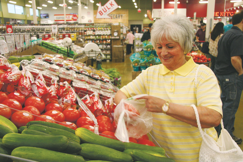 Choosing some tomatoes on Aug. 8, Maria Rickman of Wheat Ridge said the new Lucky's Market was close enough to walk to from her condo.