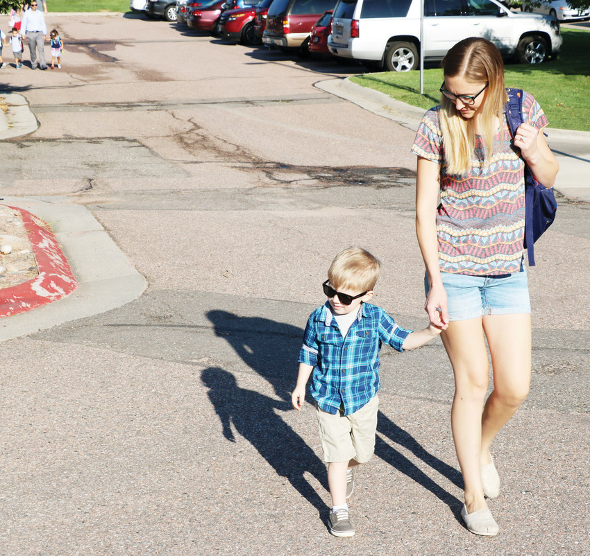 Christine Gustafson walks her 4-year-old son, Bode, to his first day of pre-K on Aug. 9 at Cougar Run Elementary School in Highlands Ranch.
