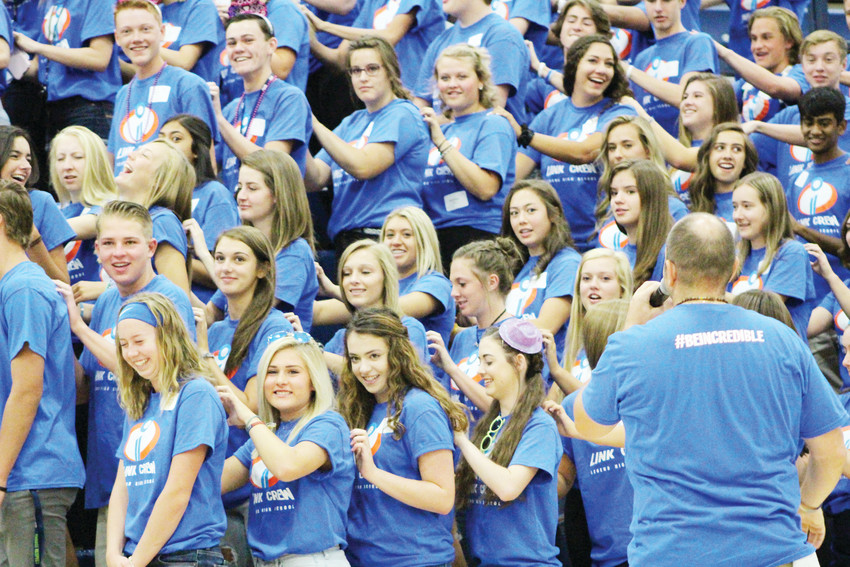 "A group of non-freshman student leaders, or the ""Link Crew,"" go through warm-ups for the first day of school at Legend High School. The Link Crew help freshmen through orientation and get acclimated to high school life."