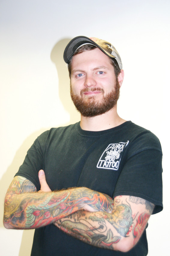 "Bart Leonard, 28, has been tattooing professionally for nearly five years and is currently employed at Adroit Tattoo in Golden. ""I enjoy making people happy with their tattoo,"" he said, ""and in turn, being proud of what I created."""
