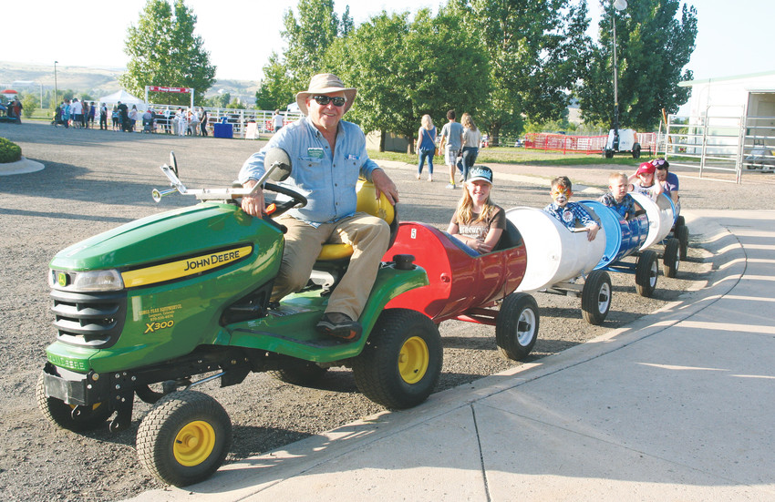 Rusty Simmons with Front Range Antique Power Association drives a barrel train full of fair-goers on Aug. 10 at the Jeffco Fair & Festival.