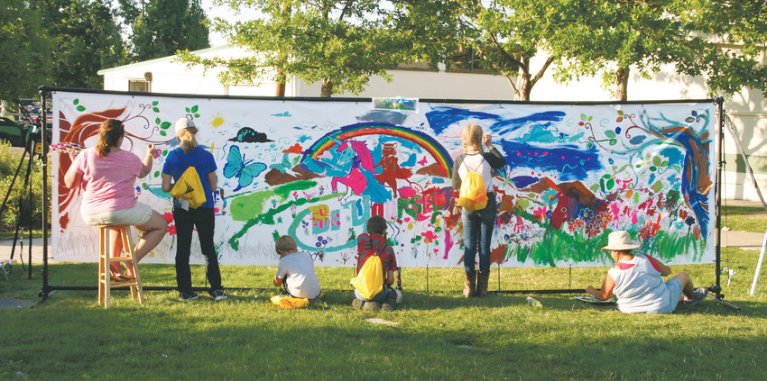Attendees of the Jeffco Fair & Festival create a mural on Aug. 10 at the Pop-up Art Zone.