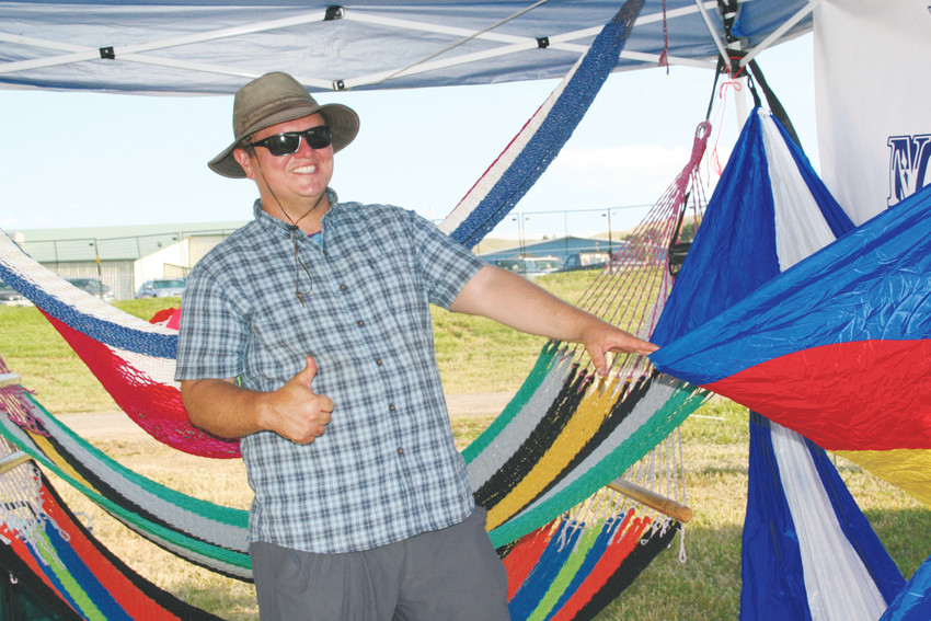 Ed Nevarro, a crafter with Colorado Hammock headquartered in Manitou Springs, shows off handmade hammocks at the locals-only Artisan Village on Aug. 10 at the Jeffco Fair & Festival.