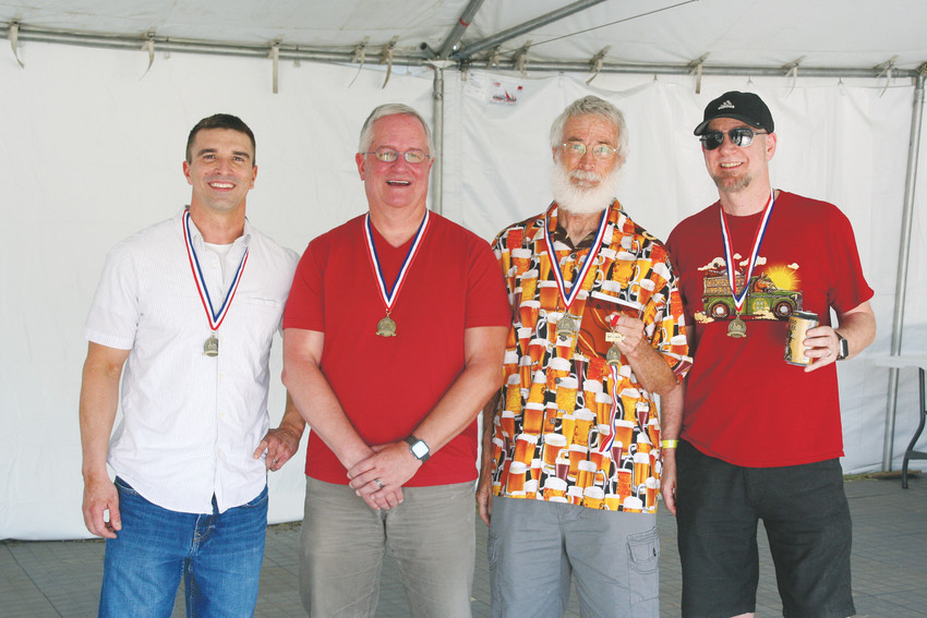 Some of the winners of the Jeffco Fair & Festival's homebrewing competition gather for a picture with their medals on Aug. 10. From left is James Prout of Lakewood, gold for his wheat beer; Glenn Berry of Elizabeth, gold for his English brown porter; Bernie Peterson of Lakewood, gold and best of show for his American brown ale; and Darrell Schrock of Erie, gold for his light beer.
